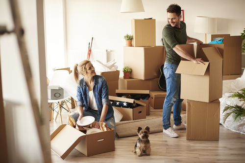 Approved Mortgage - A couple with a dog moving into a new home